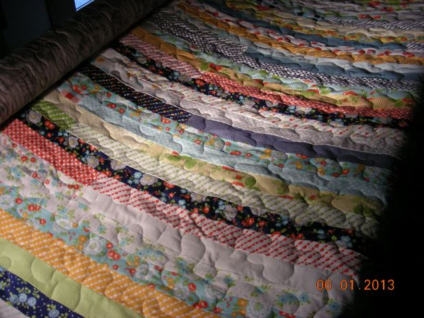 Amanda V. Jelly Roll Strip Quilt
