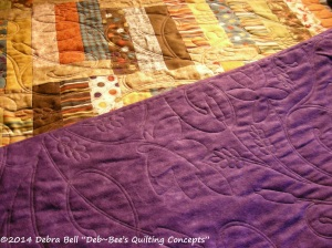 Flannel purple back shows off the quilt design.