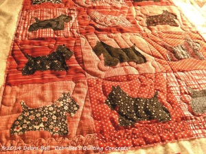 Quilted with Dog Bone meander and Dog Command line across the bottom